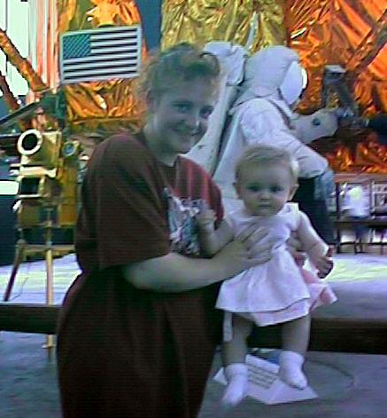 Kathy & Sydney in front of lunar lander module at the National Air and Space Museum.