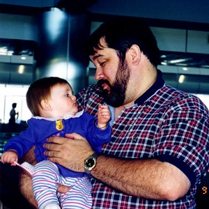 """""""Should I brush your beard?"""" Sydney Jean Kane with Uncle John at the Denver CO airport. Sydney and Mom are on their way to Los Angeles CA where they'll meet Dad."""