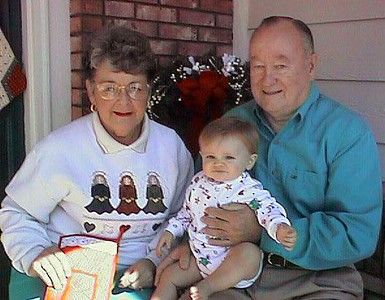 Grandma and Grandpa hoping for a Christmas card picture with Sydney Jean Kane.