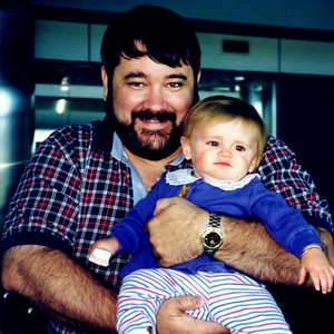 Sydney Jean Kane with Uncle John at the Denver CO airport. Sydney and Mom are on their way to Los Angeles CA where they'll meet Dad.