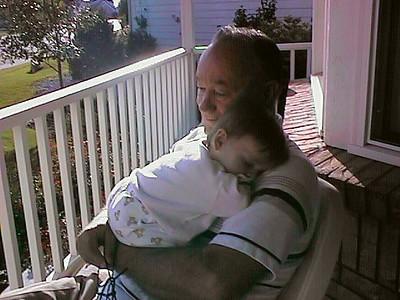 Grandpa getting plenty of snuggling from Sydney Jean Kane.