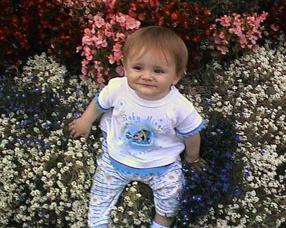 Sydney Jean Kane sitting pretty in her grandparent's backyard flower bed.