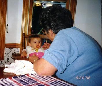 Sydney Jean Kane getting dinner from Grandma, Mary Clare Kane