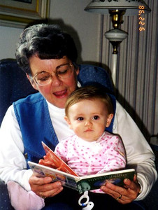 Mary Clare Kane reading a story to her granddaughter, Sydney Jean Kane