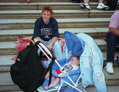 """Kathy and Sydney on the steps of the U.S. Capitol at 4 p.m. waiting for the 8 p.m. PBS CAPITOL FOURTH 1998 free concert by the National Symphony Orchestra and the 9 p.m. fireworks show over the Washington Monument.   The concert was performed on the west lawn of the U.S. Capitol. Erich Kunzel conducted the performance, which was hosted by Tony Danza, and featured Michael Feinstein, Harolyn Blackwell and others. The fireworks display was set against the National Symphony's stirring performance of Tchaikovksy's """"1812 Overture"""" and a John Philip Sousa march."""
