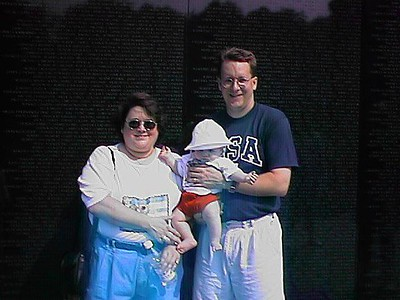 """Kathy, Sydney and Pat in front of """"the wall"""" at the Vietnam Veterans Memorial."""