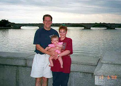 Pat, Kathy and Sydney along the Potomac River with the Arlington Memorial Bridge in the background.