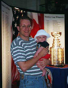 Pat and Sydney Kane in front of the National Hockey League's Stanley Cup on display at Union Station. The bowl that currently sits atop the Stanley Cup is a carefully constructed copy of the original bowl purchased by Lord Stanley in 1893. The original trophy was retired in 1969 because it had become brittle and easily damaged. It can still be viewed at the Hockey Hall of Fame in Toronto.