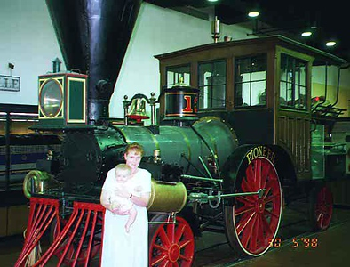 Kathy and Sydney in front of the Pioneer at the National Museum of American History. The Pioneer was built by Seth Wilmarth of Boston in 1851. In 1862, Confederate cavalry general J. E. B. Stuart and his troopers damaged the locomotive when they burned the Chambersburg, Pennsylvania, railroad yard.