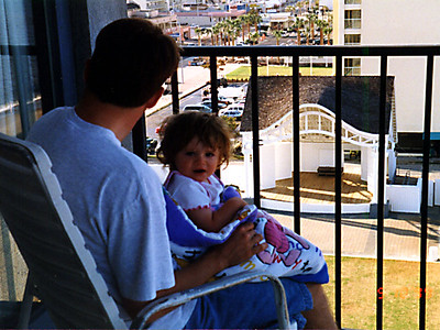 Pat and Sydney enjoying the view off the hotel balcony.
