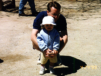 Pat is trying to get Sydney to pet the animals at the Philadelphia Zoo.