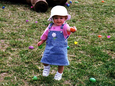 """""""See Mom, an egg!"""" Sydney Jean Kane enjoying a pre-Easter egg hunt at Butler's Orchard. Pat missed out since he was in California on business. That didn't stop Sydney and Kathy from having tons of fun."""