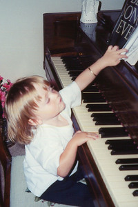 Sydney banging out some tunes on her Grandma's piano.