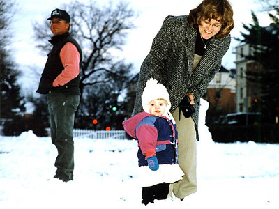 """""""Oh boy! My cousins and Aunt Betsy and Uncle Frank came from California to play in the snow with me."""" Sydney Jean Kane with Betsy and Frank Roth in front of The Kennedy-Warren."""