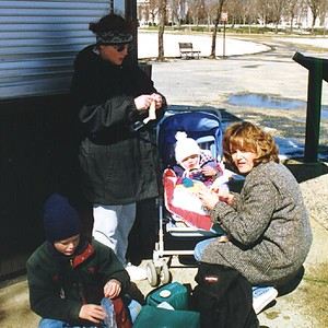 Multi-course meal. Aunt Betsy feeding apple sauce to Sydney Jean Kane, while Kathy prepares the next course--string cheese. Grady Roth fending for himself in Constitution Gardens.