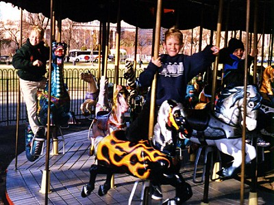 Grady, Ryan and Nathan Roth enjoying the carousel on the National Mall.