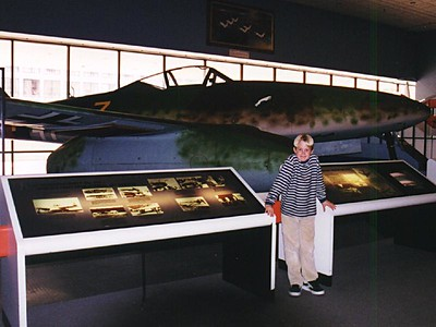 Grady Roth in front of an exhibit at the National Air and Space Museum that shows Germany's development of the first fighter jets.