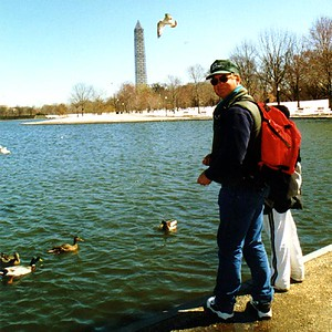 Frank and Ryan Roth feeding the ducks in Constitution Gardens with the Washington Monument and its ugly scaffolding in the background.