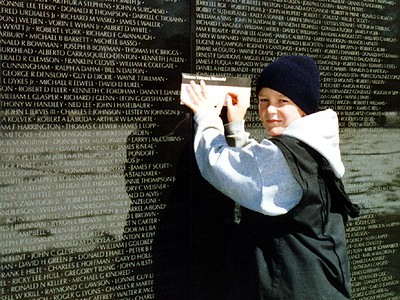Ryan Roth copying the name of a King City man from the wall of the Vietnam Veterans Memorial. Grady and Nathan copied the names of the remaining two King City residents that died for their country during this war.