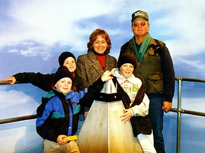 """Betsy and Frank Roth with their three boys, (L to R) Nathan, Grady and Ryan, """"at the top"""" of the Washington Monument. Unfortunately, the Monument is undergoing major restoration and isn't as pretty on the outside as it normally is (dang scaffolding). Fortunately, a temporary exhibit, the Washington Monument Interpretive Center, is on the monument grounds. It's a shame that it's only temporary as it's quite good.  Roth's come to the City. Our nephews came for a visit and brought along Mom (Betsy) and Dad (Frank). We saw a little of everything Washington DC has to offer. We did a LOT of walking and my poor little nephews let me know about it. Strange thing is that once we returned to the apartment, the first thing they would do was run to the basement to play basketball! :-) (Mar 1999)"""