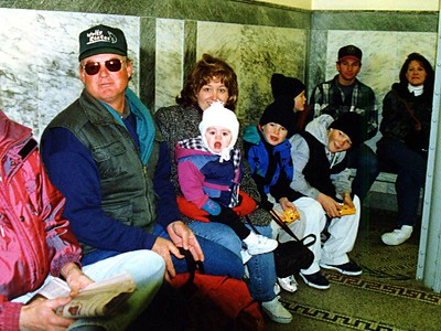 Yea! Everyone is about to go up the elevator to the top of the Washington Monument. Frank, Sydney Kane on Betsy's lap, and Nathan, Ryan and Grady Roth.