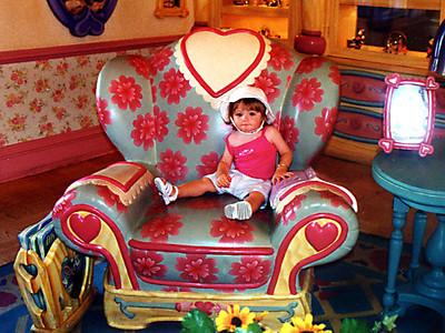 Sydney getting to take a rest in Minnie's house in Walt Disney World.