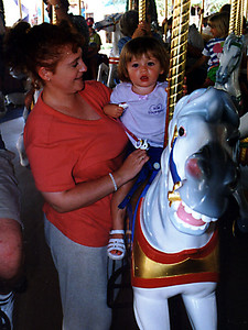 Kathy and Sydney enjoying a carousel ride at Walt Disney World.