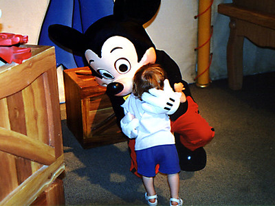 Sydney is giving some loving to Mickey Mouse.