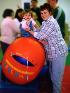 """Sydney Jean and Kathy Kane enjoying themselves at Gymboree. They're bouncing up and down and singing """"row, row, row your boat..."""" These classes have been a lot of fun for both mother and daughter."""
