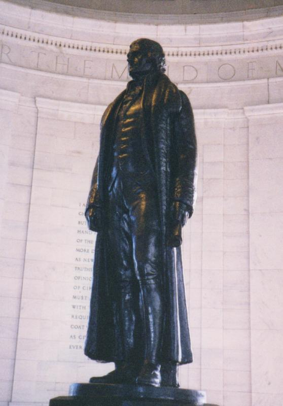 The statue of Thomas Jefferson, by Rudolph Evans, looks out from the interior of the Thomas Jefferson Memorial toward the White House. President Franklin D. Roosevelt had trees removed between the two sites in order for himself, and future Presidents, to gain a better view of the memorial and inspiration from the memorial.