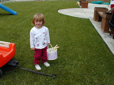 Sydney's doing a great job finding Easter Eggs in our backyard.
