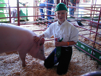 Grady and the award-winning pig that he raised for his 4H project.