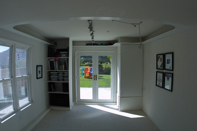 "We ""added"" a hobby room to our home in the first part of 2000, with Pat doing the majority of the work. The hobby room is a partial garage conversion that changed an L-shaped three car garage into a standard two car garage plus a bonus room.   To let in light and provide better access to the yard, Pat installed double hung windows and French doors. He also enclosed the hot water heater and added shelves for Kathy to store her Creative Memories products."