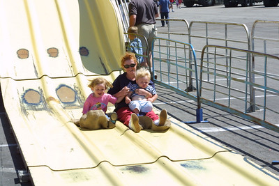 Kathy just took Sydney and Christopher down the Super Slide at the Seabee Days festival
