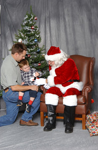 Pat, Christopher and Santa at the NFESC Christmas Party.