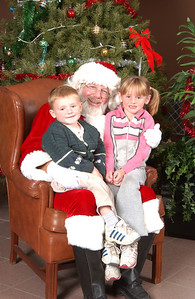 Christopher and Sydney Kane with Santa at the 2003 NFESC Children's Christmas Party.