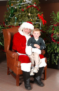 Christopher Kane with Santa at the 2003 NFESC Children's Christmas Party.