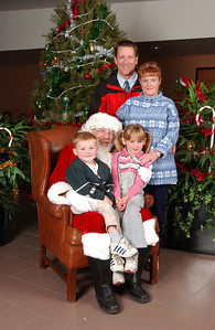 Patrick, Kathy, Sydney and Christopher Kane with Santa at the 2003 NFESC Children's Christmas Party.