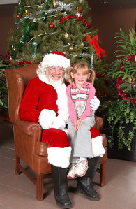 Sydney Kane with Santa at the 2003 NFESC Children's Christmas Party.