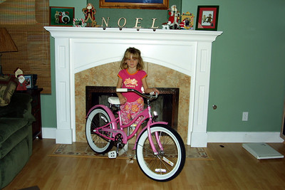 Sydney with her new bike--a 20-in Electra Hawaii beach cruiser--that was delivered by Santa. Notice the matching clothes, which had been an earlier gift from family in Australia.