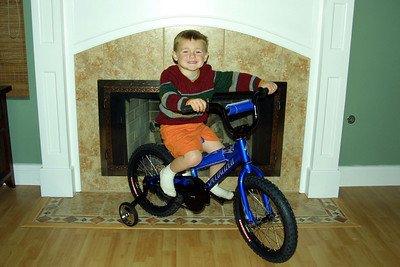 Christopher with his new bike--a 16-in Specialized Hotrock mountain bike--that was delivered by Santa.