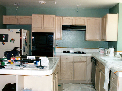 The kitchen is being painted by Benito's Painting with Dunn Edwards' Suprema in the Horn-to-Horn color. We're extremely pleased with the color as it provided a nice contrast to the cabinets. This shot of the kitchen also shows the old appliances, which were later replaced.