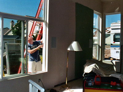 Pat installing trim around the new vinyl double-paned windows. Definitely not part of the original plan, but the existing, cheap double-paned aluminum windows were fogging over with increasing regularity.