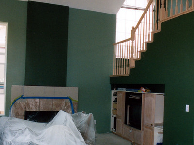 The family and living rooms both had an accent color. The paint is Dunn Edwards' and the lighter green is Horn-to-Horn while the darker green is Canopy. The staircase really pops against the dark green.