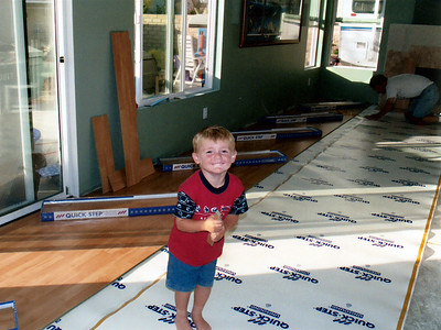 Christopher is enjoying installation of the laminate flooring. The difficult part for Pat was getting started, but once the first few rows went in, things moved along pretty quickly. This floating floor (Quick-Step's Uniclic Planks (U-781 Select Birch)) just snaps together and requires no glue. Almost 900-sq.ft. installed solo in just two weekends.