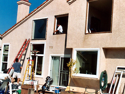 New vinyl double-paned windows being installed on the back of the house. Definitely not part of the original plan, but the existing, cheap double-paned aluminum windows were fogging over with increasing regularity.