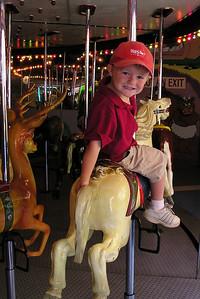 Christopher enjoying the carousel in Ventura Harbor.