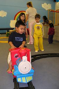 Isaac having fun riding the train at his 3rd birthday party at My Gym.