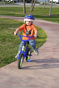 Christopher is doing great riding a 2-wheeler, which he learned to do on his own yesterday; however, I'm going to let him practice for a while on his old bike before I take the training wheels off his new bike, which is a little bigger.