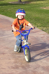 After learning to ride a 2-wheeler on his own yesterday, Christopher went to the park today for room to practice. He did crash a few times, but otherwise did quite well.